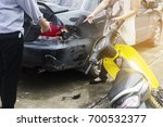 accident of motorcycle and car | Shutterstock . vector #700532377