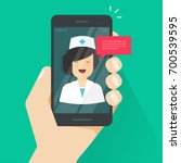 doctor online on mobile phone... | Shutterstock .eps vector #700539595