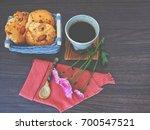 Small photo of Almond cookie, wicker basket, coffee mug, flowers, on wood. Almond cookie in wicker basket, coffee mug and chrysanthemum pink. On wood. in vintage tone.