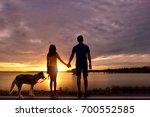 couples  hand  dog and natural... | Shutterstock . vector #700552585