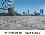 empty pavement and modern... | Shutterstock . vector #700556581