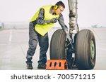 airport worker mechanic   Shutterstock . vector #700571215