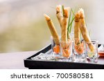 Small photo of A la carte designed crispy deep-fried spring roll in mini glass serve for snack time