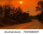 before sunset on a rural road... | Shutterstock . vector #700588009