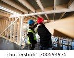 carpenters working at... | Shutterstock . vector #700594975