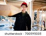 carpenter smiling while... | Shutterstock . vector #700595035