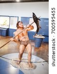 Small photo of 24 MARCH 2017, VIENNA, MUSEUM OF NATURAL HISTORY, AUSTRIA: Caveman homo hunter fishermen at the exhibition in the museum, concept of the Darwin theory of evolution