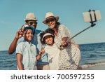 happy african american family... | Shutterstock . vector #700597255