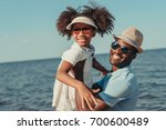 happy african american father... | Shutterstock . vector #700600489