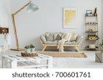 yellow painting hangs over grey ... | Shutterstock . vector #700601761