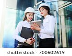 two young pretty business women ... | Shutterstock . vector #700602619