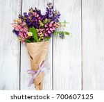 lupine flowers on a old wooden... | Shutterstock . vector #700607125