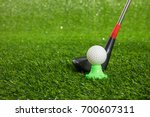 closeup of toy golf ball and... | Shutterstock . vector #700607311