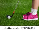 closeup of a child golfer with... | Shutterstock . vector #700607335