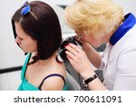 the dermatologist examines the... | Shutterstock . vector #700611091