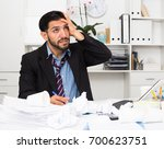 man employee is indignant... | Shutterstock . vector #700623751