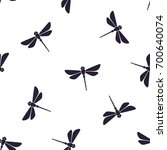 Stock vector seamless vector illustration pattern with silhouettes of flying dragonfly with a straight body on 700640074