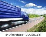 blue truck speeding on country... | Shutterstock . vector #70065196