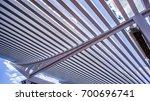 sky through wooden bars | Shutterstock . vector #700696741