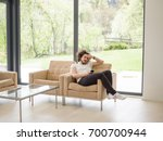handsome casual young man using ...   Shutterstock . vector #700700944