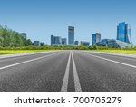 city road through modern... | Shutterstock . vector #700705279