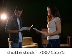 actors reading their scripts on ... | Shutterstock . vector #700715575