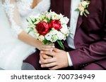 bright wedding bouquet in the... | Shutterstock . vector #700734949