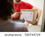 home delivery service  mail ... | Shutterstock . vector #700744729