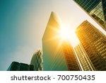 skyscraper glass facades on a... | Shutterstock . vector #700750435