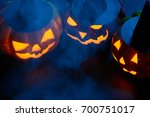 three halloween pumpkins with...   Shutterstock . vector #700751017