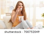 emotional pregnant woman eating ... | Shutterstock . vector #700752049