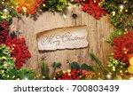 christmas wooden background   Shutterstock . vector #700803439