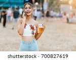 young woman sitting at music... | Shutterstock . vector #700827619
