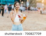 young woman at music festival... | Shutterstock . vector #700827709