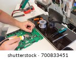 tv repair in the service center ... | Shutterstock . vector #700833451