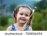 little girl put wheat spikelets ... | Shutterstock . vector #700836454