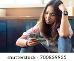 stressed young asian woman...   Shutterstock . vector #700839925