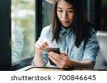 young asian woman using... | Shutterstock . vector #700846645