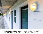 row of hotel or motel doors... | Shutterstock . vector #700849879
