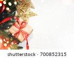 christmas gift box on wooden... | Shutterstock . vector #700852315