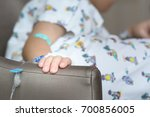 hand of sick boy on the sofa in ... | Shutterstock . vector #700856005