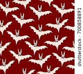 seamless pattern with bats.... | Shutterstock .eps vector #700858891
