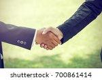 handshake. it is a collective... | Shutterstock . vector #700861414