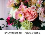arrangement of fresh flowers in ... | Shutterstock . vector #700864051