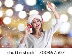 young woman in santa's hat with ... | Shutterstock . vector #700867507