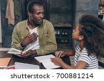 father helping daughter do the... | Shutterstock . vector #700881214