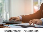 a businessman analyzing... | Shutterstock . vector #700885885