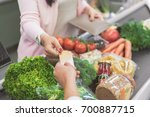 customer giving card to... | Shutterstock . vector #700887715