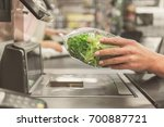 Small photo of Adult cashier lady working in supermarket