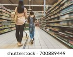 mom and daughter doing shopping | Shutterstock . vector #700889449